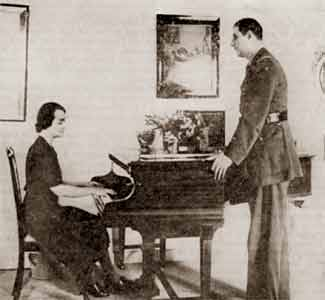 The General, in London, looking at Madame de Gaulle playing the piano...